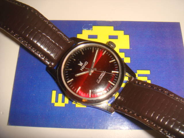 Nino: Automatic Red / Black Face Watch